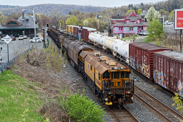 The LORAM rail grinder heads west across the diamond at MP83 in Palmer MA.<br /> 5/1/2019