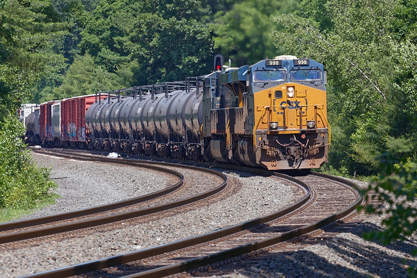 After dropping the auto racks at the EBSR, Q436 heads east on the siding.<br /> 6/26/2020