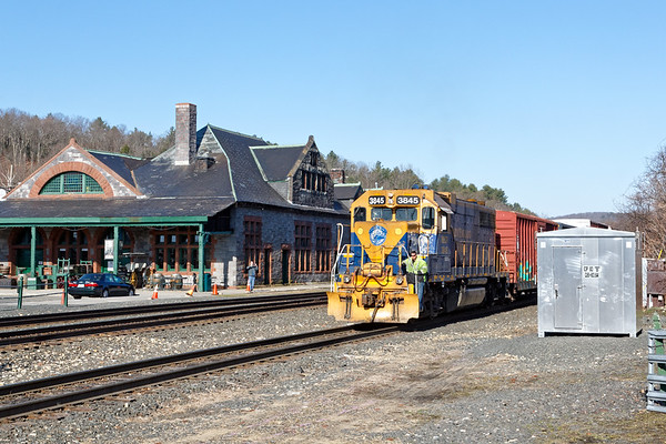 In the warm early morning sun, NECR 3845 takes the CSX yard lead across from the historic depot at MP83 in Palmer MA.<br /> 3/26/2020