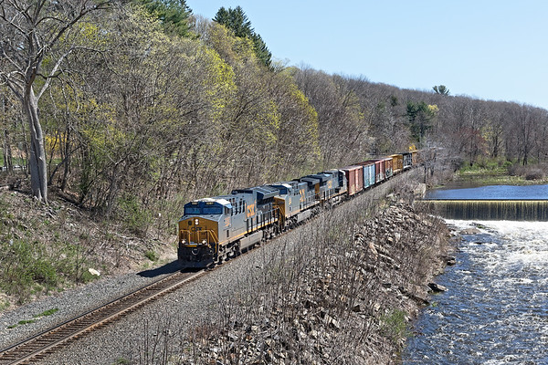 As soon as 426 went through, the signals went green for a westbound and less than an hour later Q427 rolled west through the early Spring foliage at West Warren MA.<br /> 5/4/2020