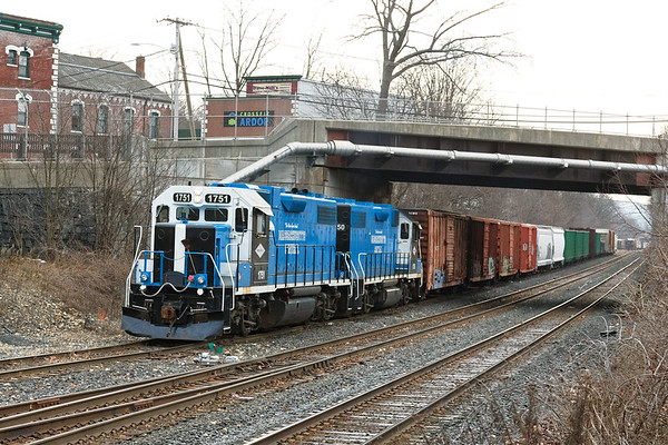 Mass Central pulls a long cut of cars out of the CSX yard in Palmer MA.<br /> 12/28/2020