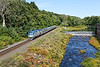 Amtrak 449, the Lake Shore Limited, drifts past the dam and mill complex near MP75 in West Warren MA.<br /> Many thanks to Anthony and all the guys who trimmed the foliage along the river bank - can actually see the train now!!<br /> 9/7/2020