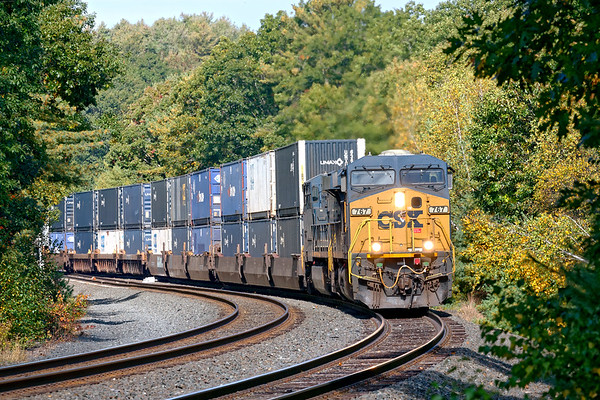 At MP60 in Spencer MA, Q008 crosses over from the main to the siding with stacks for Worcester.<br /> 9/29/2020