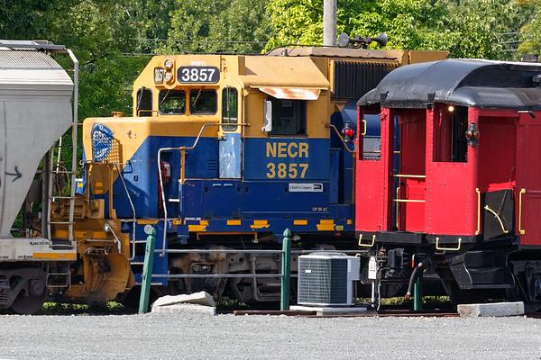 Something old, something new(er)...<br /> NECR 3857 works their yard in Palmer MA.<br /> 9/4/2020