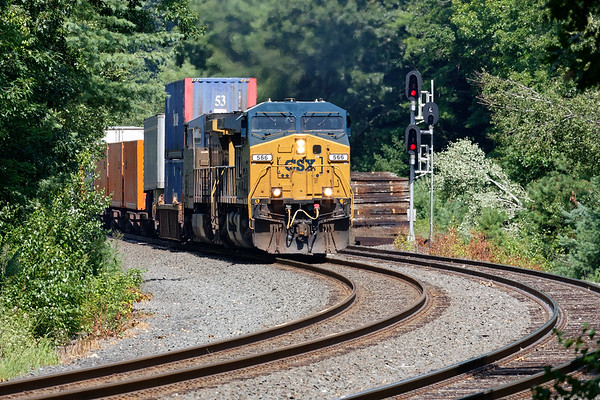 Train Q008 splits the signals at MP60 in Spencer MA with a long drag of containers for Worcester.<br /> 8/12/2020
