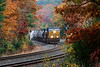 Train Q436 runs through some rich Fall color in the S-curves at MP60 in Spencer MA.<br /> 10/23/2020