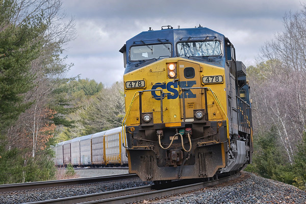 Q268 backs down the siding at MP60 in Spencer MA with a long drag of auto racks for the EBSR.<br /> 4/1/2020