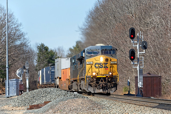 Q012 blasts through MP57 in Charlton MA with a short train for Worcester.<br /> 4/6/2020