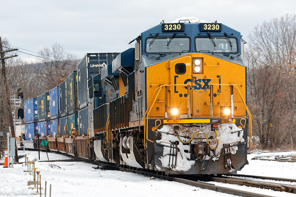 With a bit of fresh snow on it's nose, Q022 rolls through Palmer MA at track speed.<br /> 12/8/2020