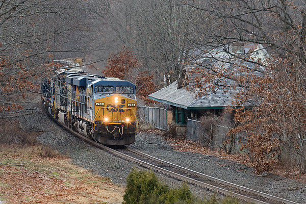 Most of the foliage has dropped allowing this view of Q436 passing the historic station in Warren MA.<br /> 12/1/2020