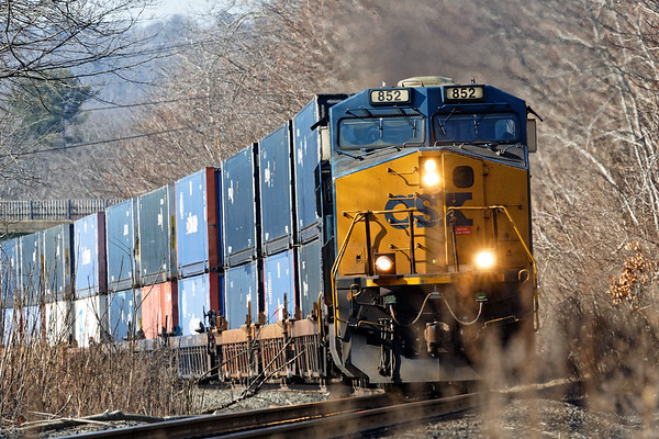 A more traditional view - Q022 starts to climb the grade in West Warren MA.<br /> 2/17/2020