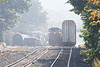 With FRED flashing good bye, Q264 passes Q426's pusher and NECR in the CSX Palmer MA yard.<br /> 9/25/2020