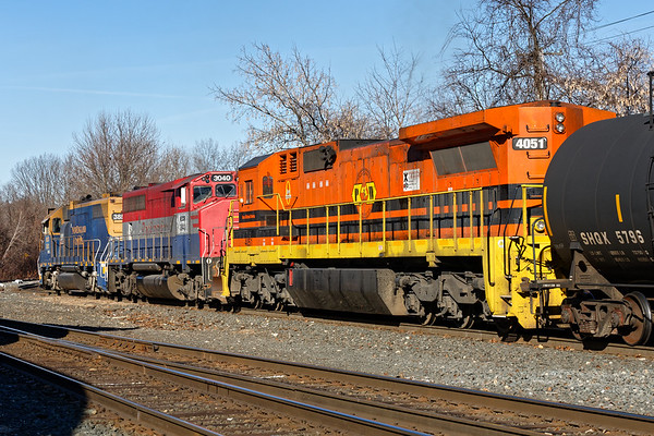 NECR rainbow consist - NECR 3857 in blue and gold, 3040 in legacy RailAmerica colors and P&W 4051 in G&W livery.<br /> 1/30/2020