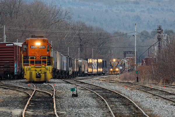 Yesterday I spent a few hours in Palmer under dark overcast skies but at least the NECR was moving. Started with 608 sitting quietly as train 603 eases through the iron bridge and up into the yard.<br /> 2/3/2020