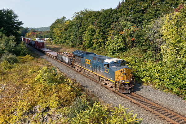 After working the yard in Palmer, Q426 heads east through some early Fall color at MP75 in West Warren MA.<br /> 9/25/2020