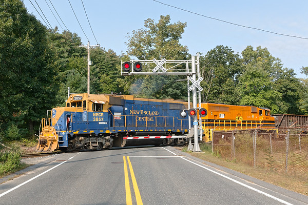 """At """"Hospital"""" crossing in Palmer, NECR 3857 and  3015  lead a train southbound to Monson MA.<br /> 9/16/2020"""