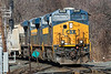 A massive Q436 hits the diamond at MP83 in Palmer MA with 3 units running elephant style on the point plus a mid-train DPU for a total of 524 axles.<br /> 3/3/2020