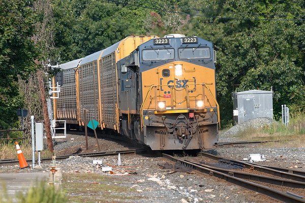 Q264 rattles across the diamond at MP83 with a long drag of auto racks for the EBSR.<br /> 9/16/2020