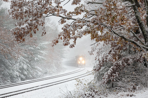 "Our first snow of the season hit today with about 6 inches of ""flurries"" making the roads pretty slick. Here Q436 emerges from the snow at MP60 in Spencer MA.<br /> 10/30/20"