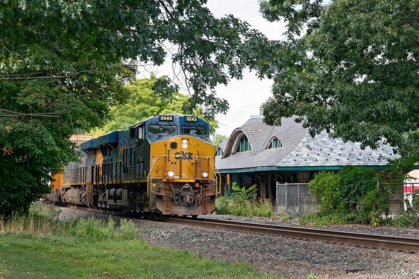 A fast moving Q008 runs past the historic Warren MA passenger station.<br /> 9/1/2020