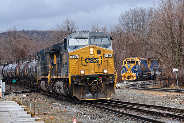 Under threatening skies, CSX train Q436 hits the diamond at MP83 in Palmer MA as NECR 3857 and 3844 wait to cross back into their yard.<br /> 2/27/2020