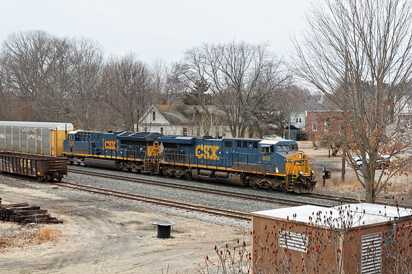 CSX train Q268 (formerly Q264) eases down the siding at MP64 in East Brookfield with a long drag of auto racks for the EBSR.<br /> 2/25/2020