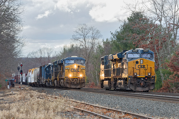 A little further east, Q436 passes Q264 light power as it crosses over from the single track to the double at MP64 in East Brookfield MA.<br /> 12/1/2020