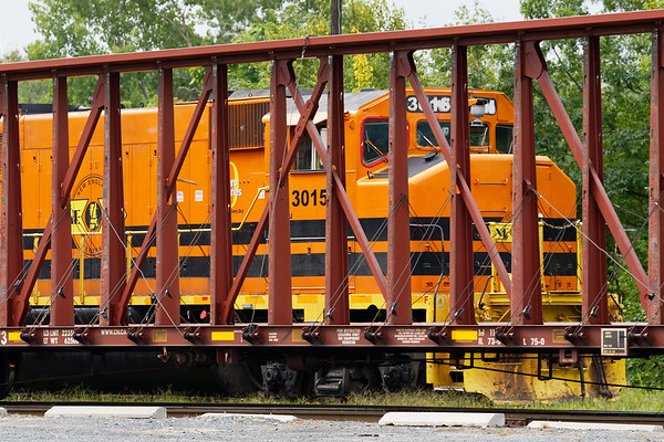 NECR 3015 peeks through an empty centerbeam in the Palmer MA yard.<br /> 9/11/2020<br /> **Never forget**