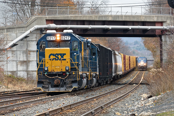 At Palmer MA, B740 holds the siding as Amtrak 449 barrels down the main.<br /> 11/11/2020