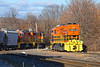 Lots of orange...NECR 2168 heads into the CSX yard at MP83 as train 608 crosses the diamond to do some switching.<br /> 11/16/2020
