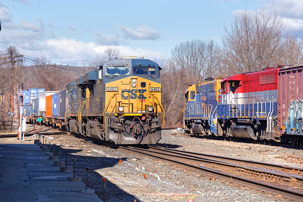 At MP83 in Palmer MA, NECR occupies the yard lead as Q022 pounds across the diamond with 2 units and a short train.<br /> 3/5/2020