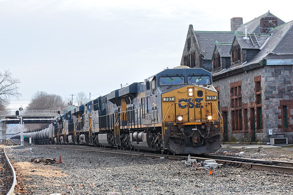 Empty ethanol train passing the historic depot at MP83 in Palmer MA.<br /> 1/7/2020