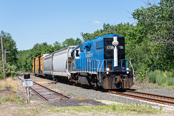 Approaching Rte 32 in Barre Plains with a couple of boxcars for the mill in South Barre.<br /> 6/8/2020