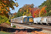 Framed by some rich Fall color, B740, the Springfield local, eases into the CSX yard with a long train including about a dozen auto racks for the EBSR.<br /> 10/14/2020