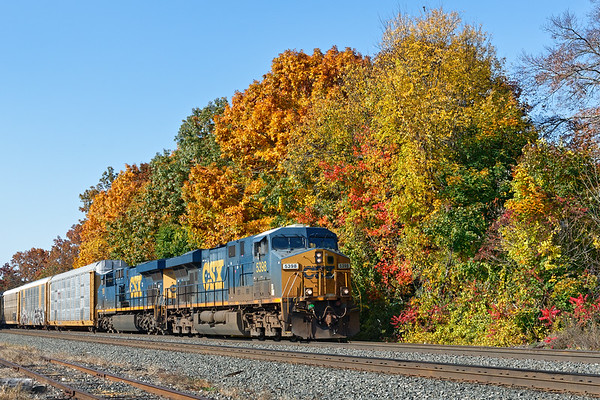 Framed by some spectacular Fall color, Q264 eases into MP64 with a long drag of auto racks for the EBSR.<br /> 10/22/2020