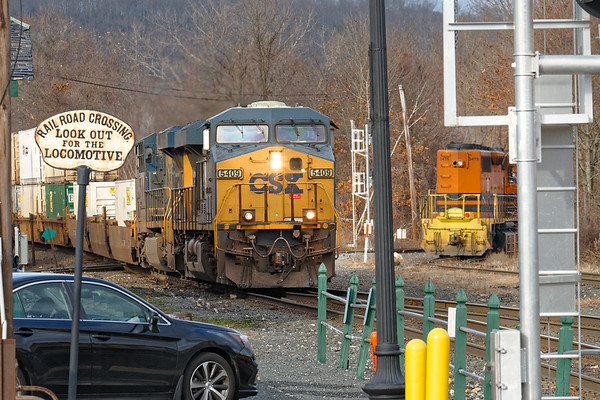 Q022 rattles across the diamond at MP83 with a very small train as NECR 3478 pulls away on the yard lead.<br /> 12/1/2020