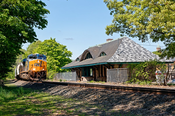 After waiting for a MASSDOT bridge inspection to be completed, train Q436 rolls past the historic Warren MA station.<br /> 5/26/2020