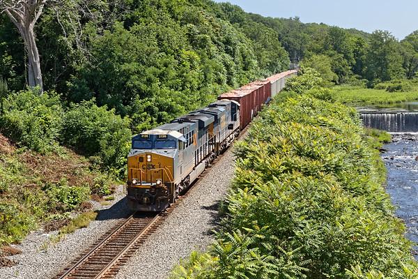 Emerging from the lush mid-summer foliage, Q437 runs through West Warren MA.<br /> 7/19/2020