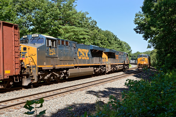 At MP60 in Spencer MA, a monster Q437 with 568 axles holds the main as Q008 crosses over to the  siding with a long drag of stacks for Worcester.<br /> 7/19/2020