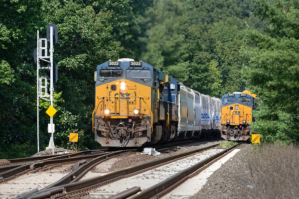 Double Firecrackers!<br /> At MP60 in Spencer MA, a long Q426 eases by on the main as Q264 holds the siding with auto racks for the EBSR.<br /> 9/1/2020