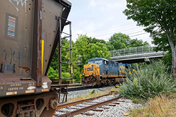 Q427 rolls past gons full of old ties at MP64 in East Brookfield MA.<br /> 9/14/2020