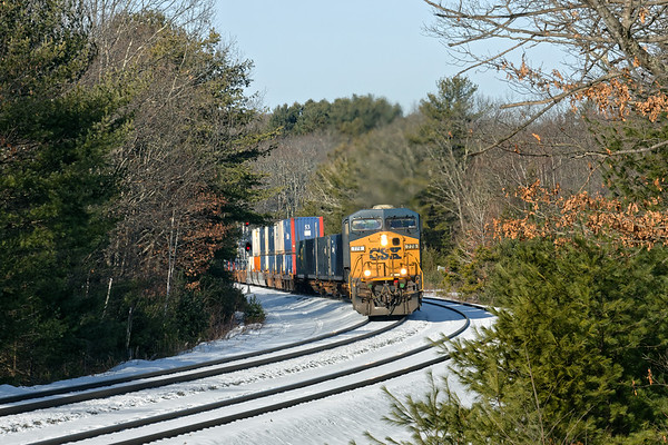 On a clear mid Winter morning, Q022 eases through the S-curves at MP60 in Spencer MA with 2 units on the point and a fairly small train.<br /> 1/23/2020