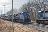 An mixed freight with four units pulls out of the Fitchburg yard past stopped EDPO.<br /> 4/15/2020