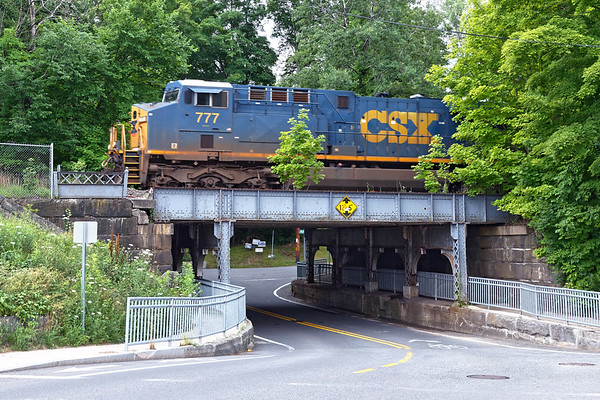 After a short stop in Palmer, Q426 came east and I was lucky enough to catch 777 crossing this awesome 1911 steel bridge near the depot in the center of Warren MA.<br /> 7/12/2020