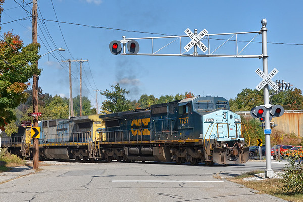 Sporting 3 of Pan Am's custom painted, brand new used CSX units, train EDPO backs into the Gardner MA yard after dropping a cut of cars for the P&W.<br /> 9/23/2020