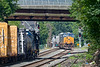 In the CSX yard in Palmer MA, train B740 holds the main as Q008 crosses the diamond and eases over onto the siding.<br /> 7/23/2020