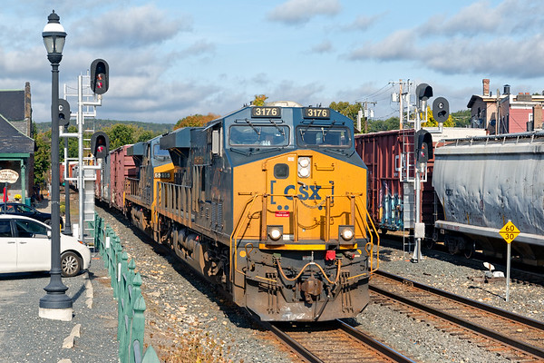 With NECR working the yard lead in the background, Q426 rolls through Palmer MA on the main.<br /> 9/29/2020