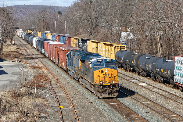 In this view from the Rte 32 bridge, Q436 rolls through the CSX yard in Palmer MA.<br /> 3/5/2020