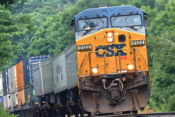 Train Q008 leans into the S-curves at MP60 in Spencer MA.<br /> 8/2/2020