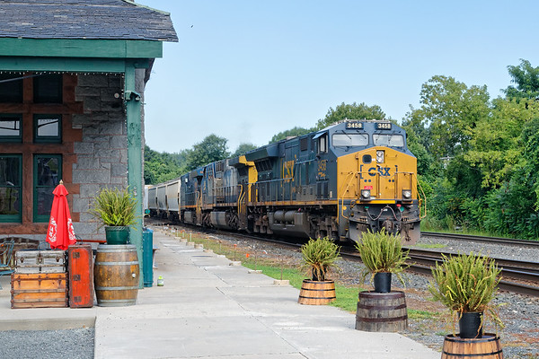 Train Q436 drifts across the diamond and past the historic depot at MP83 in Palmer MA.<br /> 7/31/2020